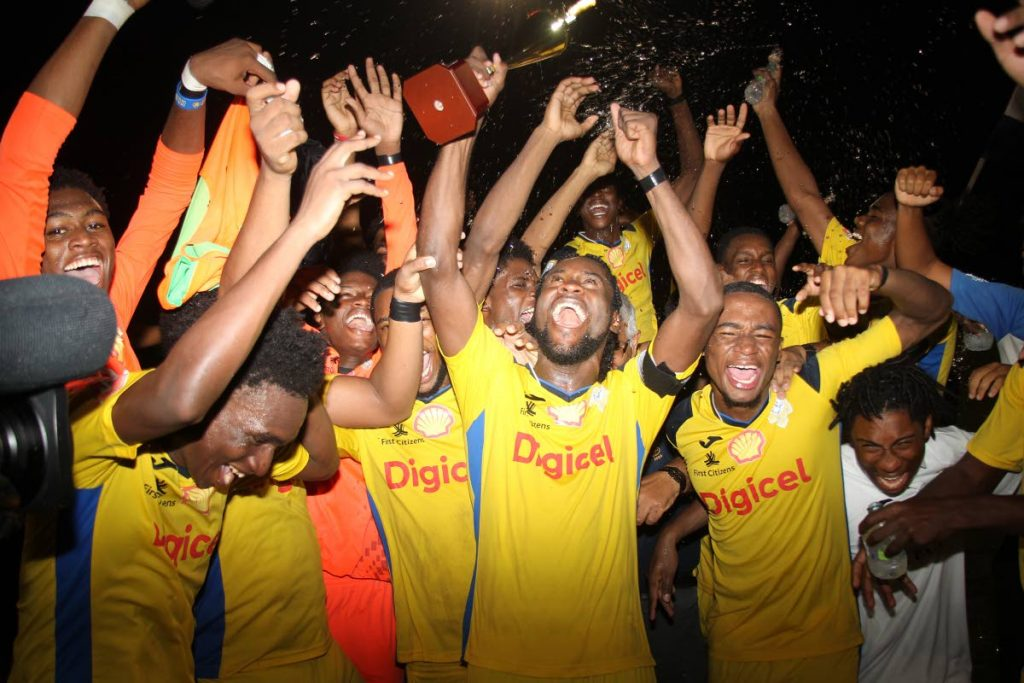 Presentation College San Fernando players celebrate after beating Naparima College, in the Coca Cola Intercol South Zonal final, at the Manny Ramjohn Stadium, on Monday.  - Lincoln Holder