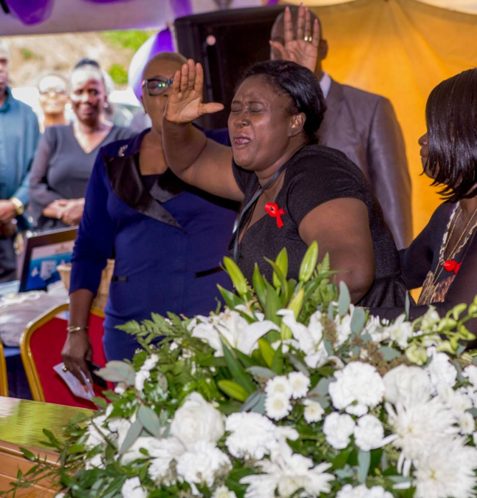 The mother of drowning victim Chrislon Anthony Walters, centre, is overcome with grief during the funeral service for her son at the Argyle Community Centre on Tuesday. Walters drowned after he tried to save his friend, Kharisha Thompson, who also died. PHOTO BY DAVID REID  - DAVID REID