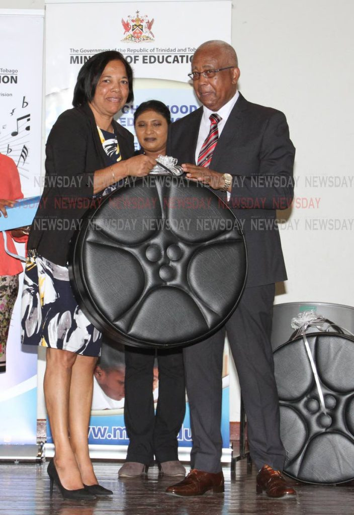 Minister of Education Anthony Garcia, gives Northeastern Sangre Grande Government  ECCE administrator Zobida Ali-Mannan a steelpan as part of the Music Education Expansion Initiative project. The event was held at the Arima New Government Primary School, Tumpuna Road South, Arima, Wednesday. - ANGELO_MARCELLE