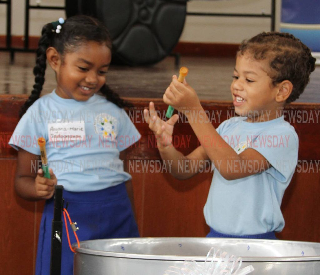 File photo: Arima New Government students Aiyana-Marie Jadoonanan and Samuel Berot, got musical with a steelpan at the Music Education Expansion Initiative project ceremony at the Arima New Government Primary School, Tumpuna Road South, Arima. - ANGELO MARCELLE