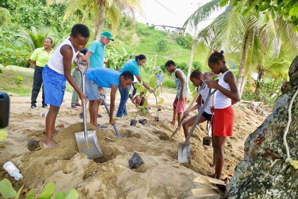 Parlatuvier children engage in a tree planting exercise along the coastline last Thursday. - DIQE