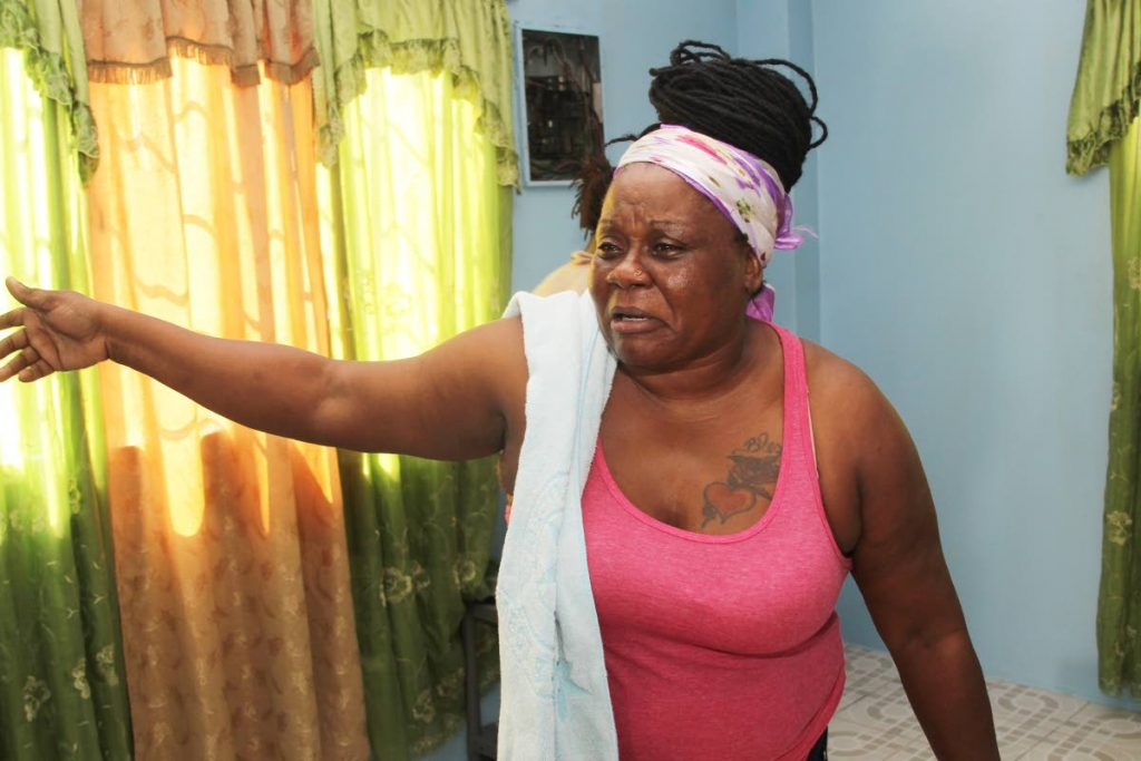 NOT MY SON: Candice Lewis Mc Kay speaks inside her Carapichaima home yesterday, hours after her son Devon was fatally shot by police. PHOTOS BY LINCOLN HOLDER - Lincoln Holder