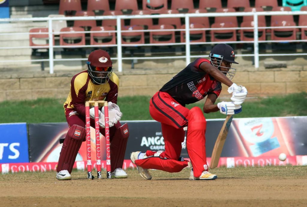 TT Red Force batsman Jeremy Solozano (right) plays a forward defensive shot, with Leeward Islands Hurricanes' captain and wicketkeeper Jahmar Hamilton looking on, during Friday's match. PHOTO BY SUREASH CHOLAI. - SUREASH CHOLAI