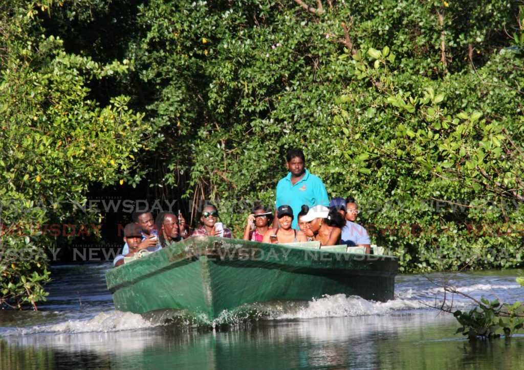 Visitors tour the Caroni Bird Sanctuary in a pirogue. The Caroni swamp is one of the areas included in a forest and protected areas management project. - FILE PHOTO