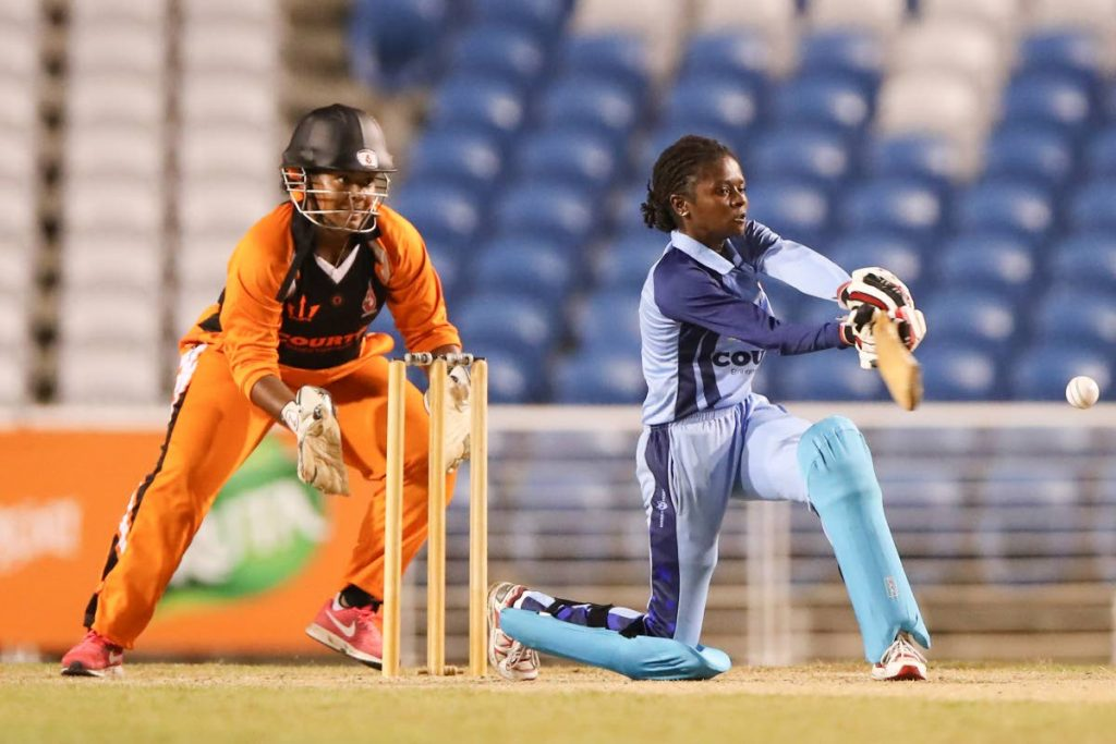 In this July 27,2018 file photo, player of the match, Central Sharks' Felicia Walters (52 runs from 67) during the semi-finals of the Courts T20 Grand Slam tournamnet 2018 between LCB Contractors Central Sharks (Blue kit) and Trident Sports Phoenix ((Black/orange kit) at the Brian Lara Cricket Academy, Taruba.  Photo: Allan V. Crane/CA-images -