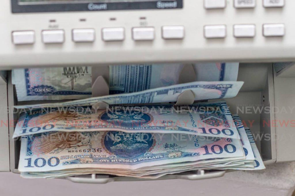 $100 notes running through a counter.  - Jeff K.Mayers