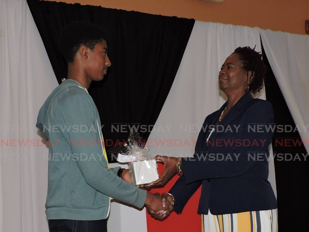Lois Leslie, CEO of E-IDCOTT, right, presents a token of appreciation to a graduate at a past Tobago Young Innovators Camp at theTobago Hotel and Tourism Institute conference room in Mt St George.  -