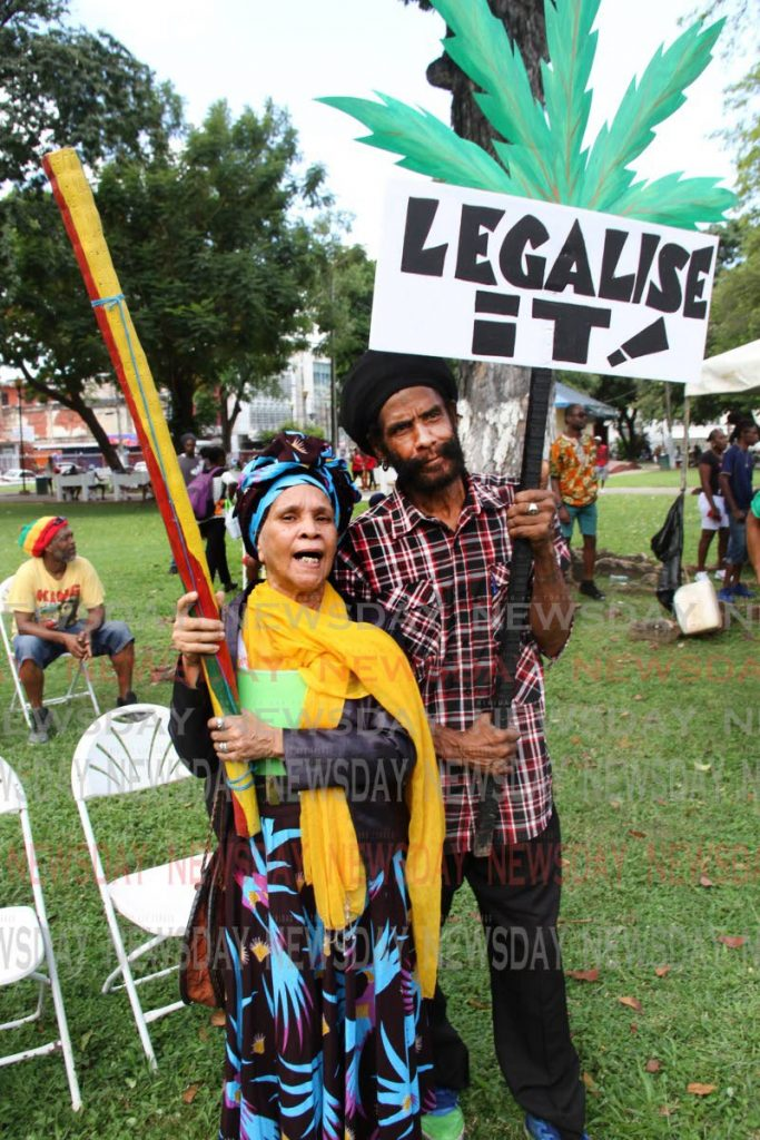 In this October 18 file photo, Theodora Uleria (Auntie Tia) and Claude Jeffers join the call legalise the use of marijuana during the All Mansions of Rastafari's National Cannabis Rally at Woodford Square in Port of Spain. - SUREASH CHOLAI