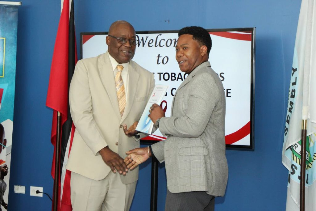 Chief Secretary Kelvin Charles, left, with Dr Kale Ferguson, chairman of Tobago Aids co-ordinating committee at a function to award him his instruments of appointment last year.  - THA Info Dept