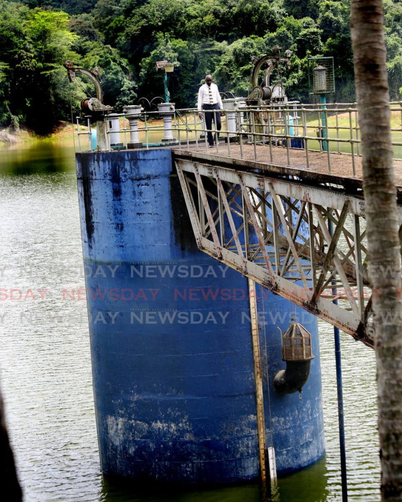In this September 18 file photo WASA's communications manager Daniel Plenty walks on a  tower at Hollis Reservoir in Valencia where the water level was low during the wet season.  - Sureash Cholai