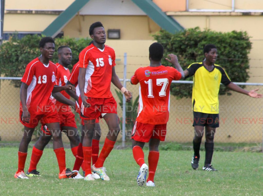 In this Oct 27 file photo, Bethel United players celebrate scoring against RSSR FC, in a Super League match, at the Hasely Crawford Stadium Training Field. - ROGER JACOB