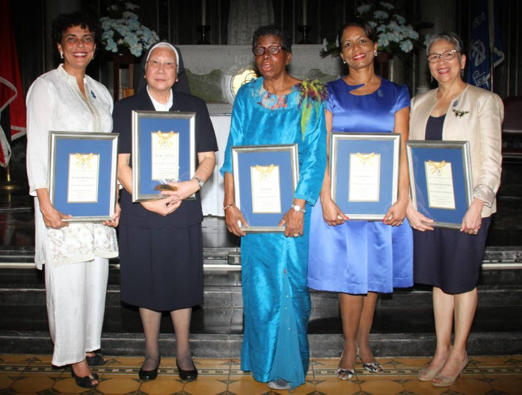 Dr Maria Bartholomew, left, Sr Mary Jean Ayow, Hazel Brown, Dr Paula Henry and Dr Michele Anne Monteil, stand proudly with their St Joseph's Port of Spain, Hall of Excellence award at the school compound. - ANGELO MARCELLE