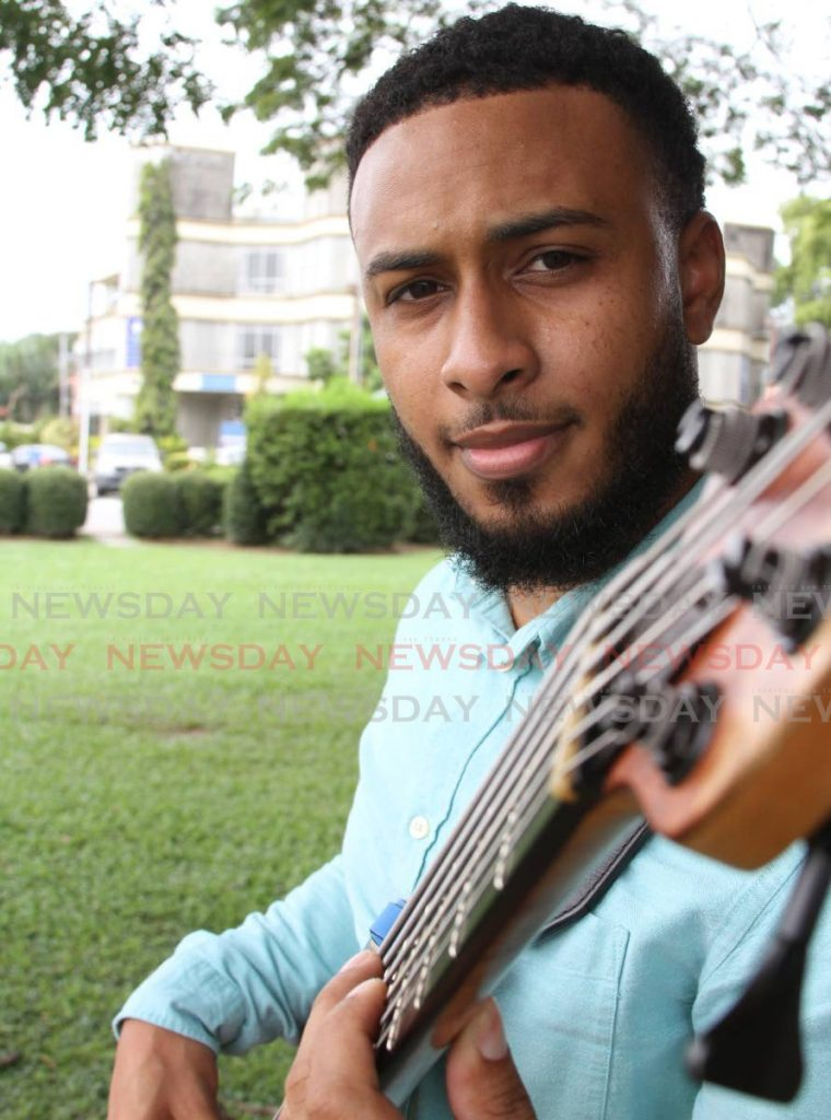 Christian bass guitarist Kohl Hosein says playing bass is an adrenaline rush. - ANGELO_MARCELLE