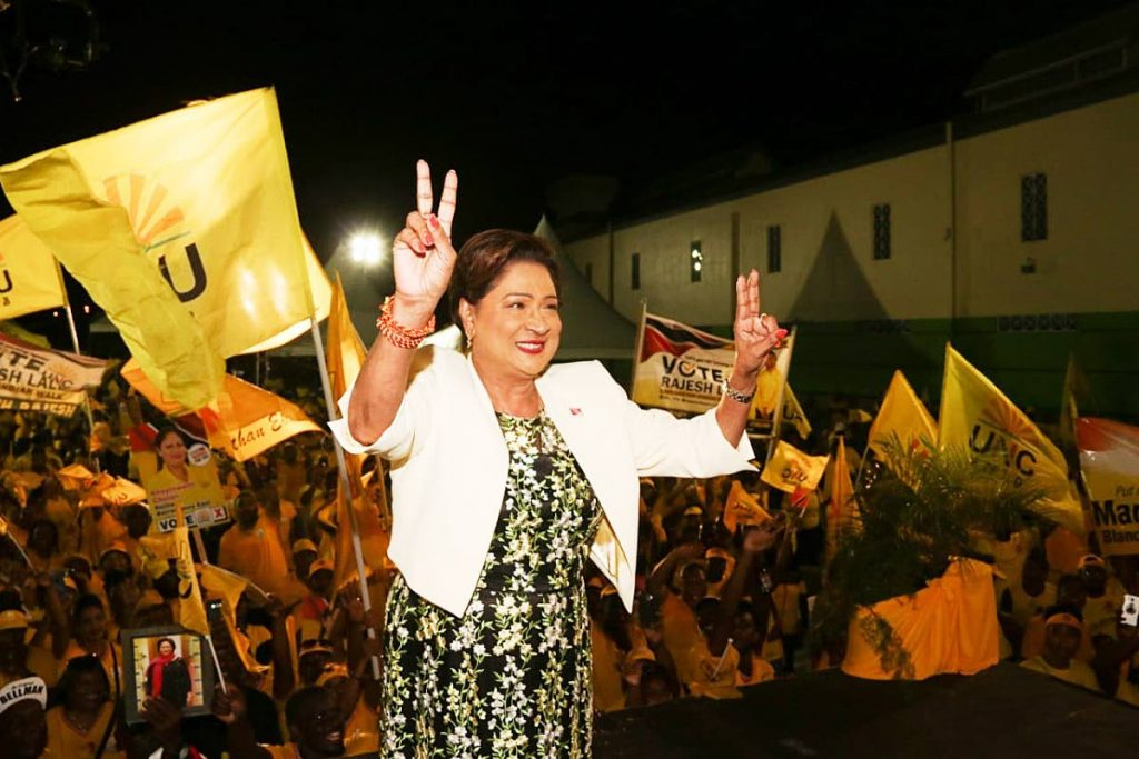 Opposition Leader Kamla Persad-Bissessar shows she's confident of victory in Monday's local government election during the UNC's final rally at Centre Pointe Mall, Chaguanas on Saturday. PHOTOS BY MARVIN HAMILTON -