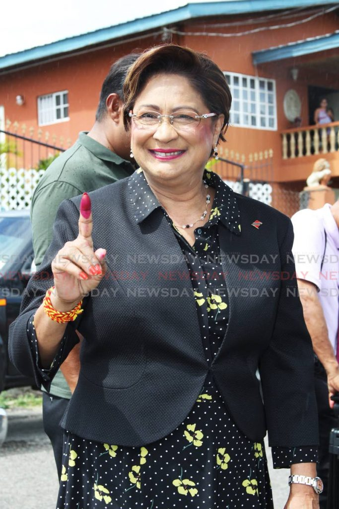 Opposition leader Kamla Persad-Bissessar cast her vote at Hermitage Presbyterian school in the local government elections.  - Lincoln Holder