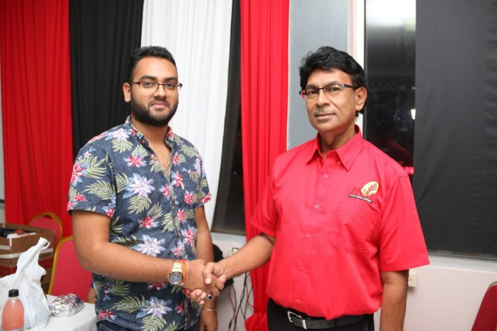 Sachin Maharaj congratulates Ryaad Hosein who won the Les Effort East/ Cipero seat. - Marvin Hamilton