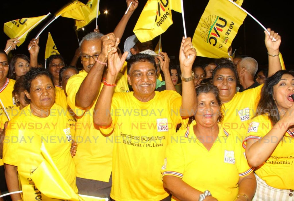 UNC supporters celebrate after local government elections at the Couva Multi-purpose Facility. - ROGER JACOB