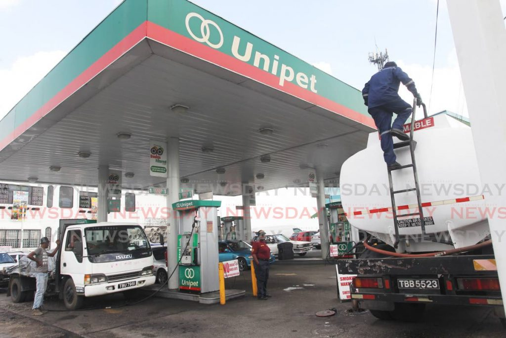 A fuel tanker servicing a Unipet station along the main road Princes Town on Tuesday even as Paria fuel trading has stopped a supply to Unipet  - Lincoln Holder