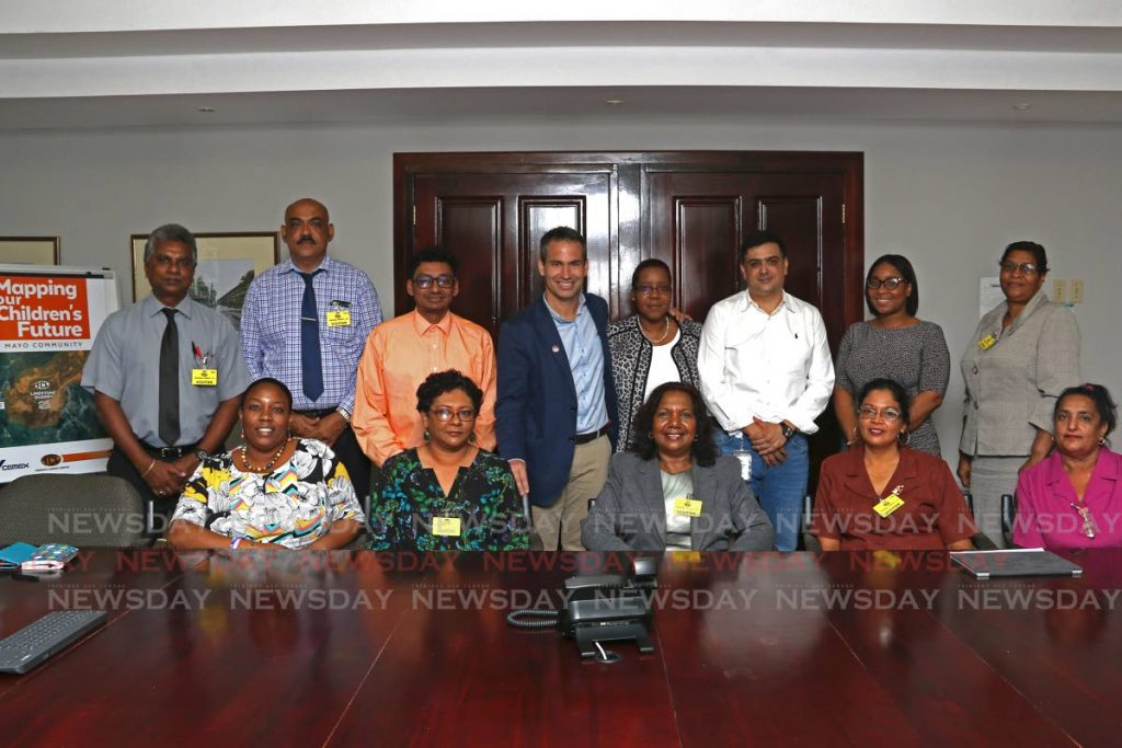 General Manager Guillermo Rojo De Diego (blue blazer), Human Resource Manager Group Cordinator Bonnie Alexis, Managing Director José Luis Seijo González and Group Legal/Secretary Michelle Davidson joins heads of primary schools at Trinidad Cement, Claxton Bay. - Marvin Hamilton