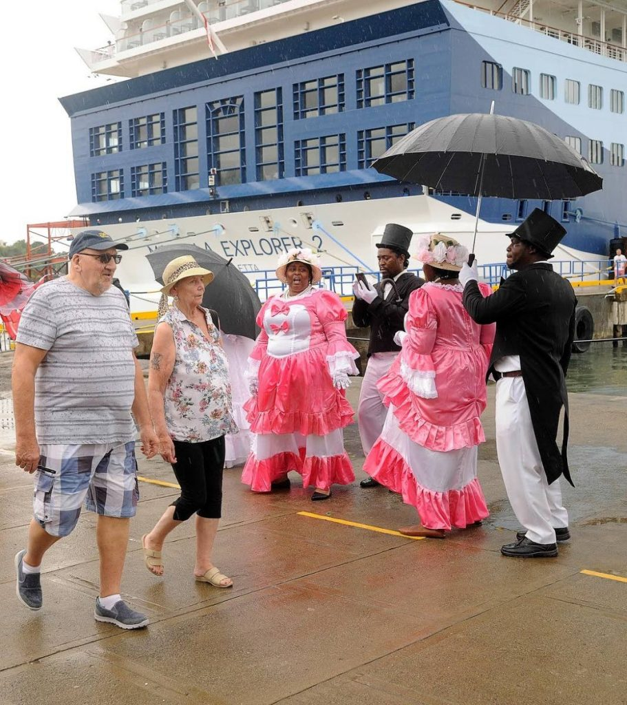 Tourists disembarking the Marella Explorer 2 on Monday were treated to a Tobago Ole Time Wedding performance on Monday.  - DIVISION OF TOURISM