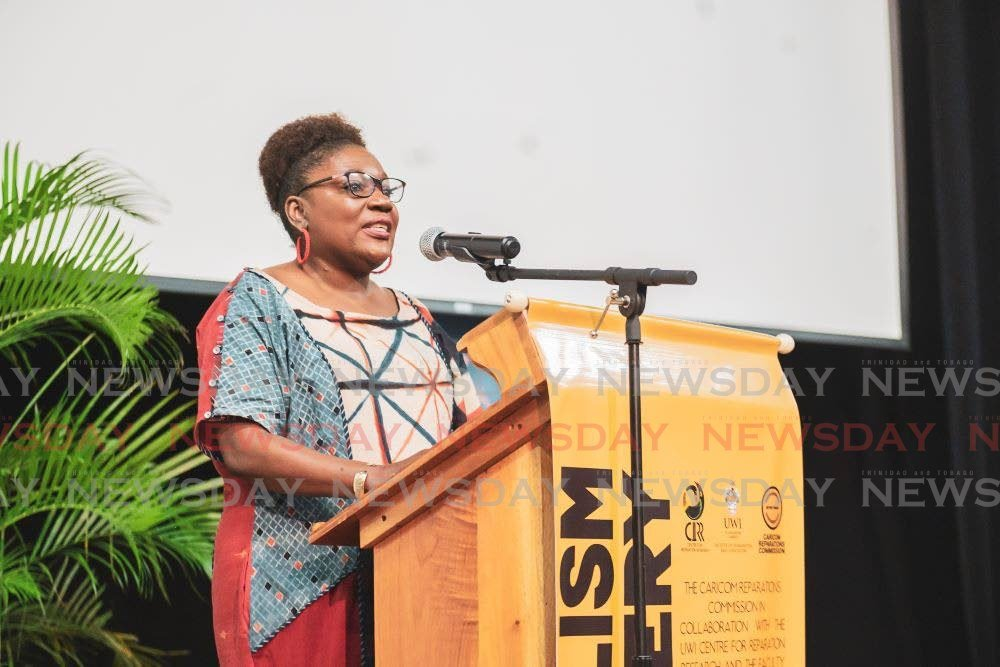 Dr Heather Cateau, senior lecturer and dean, Faculty of Humanities and Education, The UWI St Augustine, delivers greetings. -