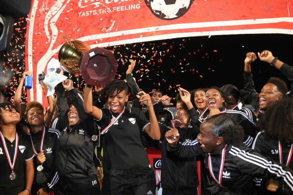 CHAMPS : Pleasantville Secondary celebrate victory at the Coca Cola Girls Intercol final, held on Wednesday, at the Ato Boldon Stadium, Couva. Pleasantville beat Signal Hill Secondary 3-1 to retain the title. - Photo by Marvin Hamilton