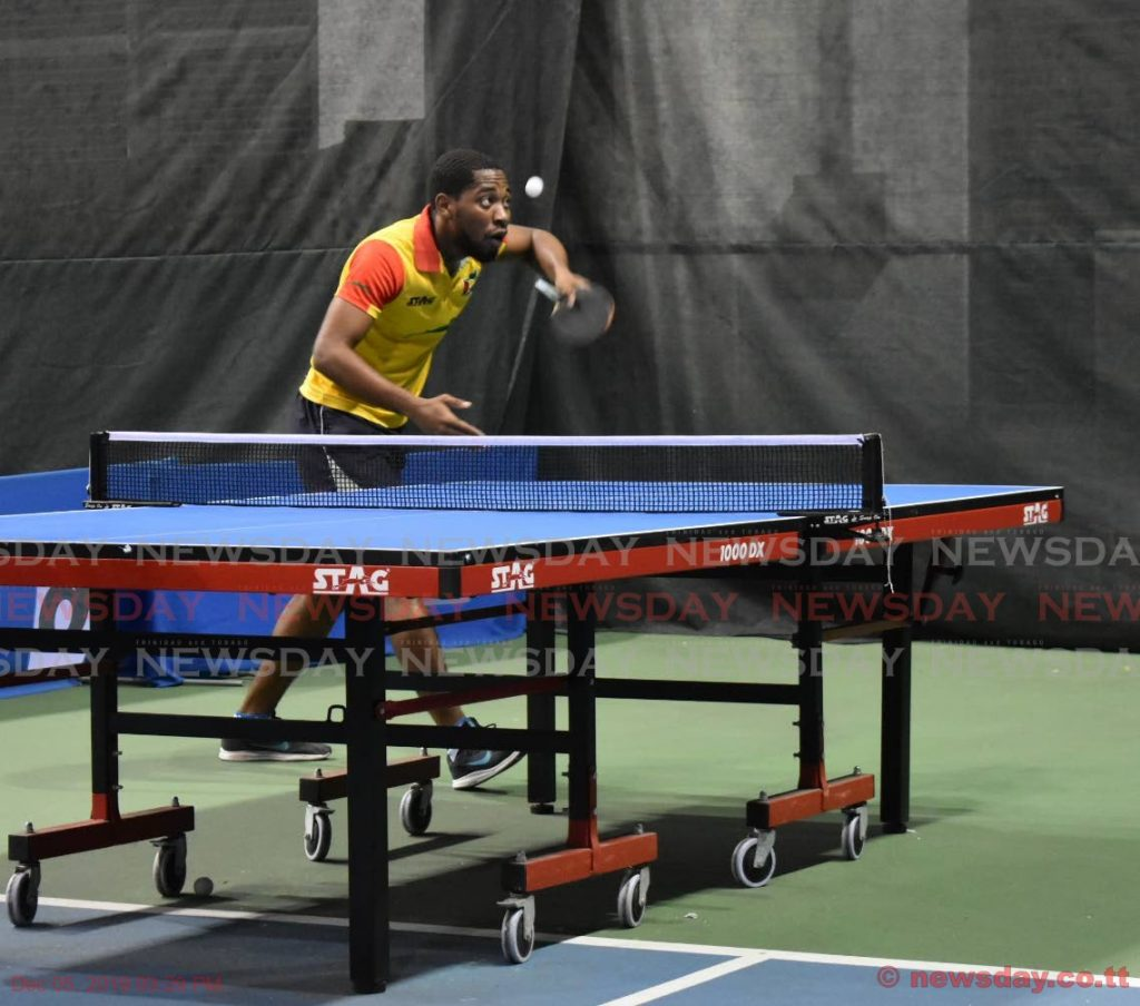 QPCC's Shemar Britton (L) serves against Aaron Wilson (not in picture) during a Super Singles Table Tennis Tournament match, held at the National Racquet Centre, Tacarigua, on Wednesday.  - Sherdon Pierre