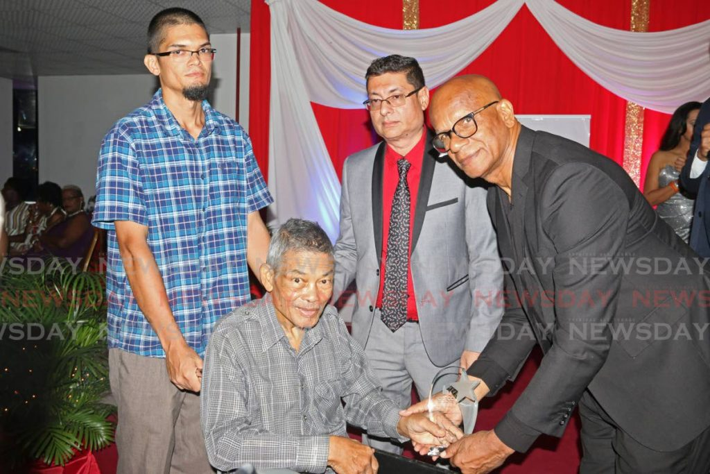 San Fernando Mayor Junia Regrello presents James Lee Wah with an award for his outstanding contribution in the field of culture, arts, education and the development of San Fernando at the Greater San Fernando Chamber of Commerce gala event, West Wood Building, Cipero Street, San Fernando. 24/11/2019 - MARVIN HAMILTON