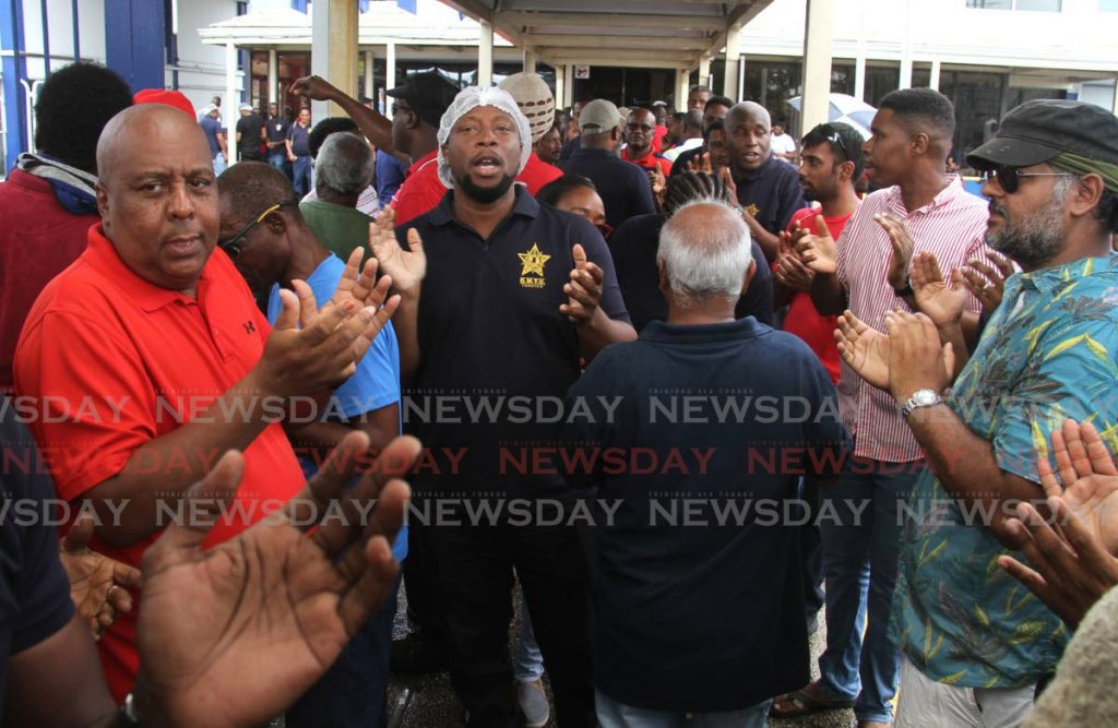 Unilever Caribbean Ltd workers during a protest at the company in Champs Fleurs on December 6. Some 178 workers will be on the breadline when Unilever starts its retrenchment process on January 17. - Ayanna Kinsale