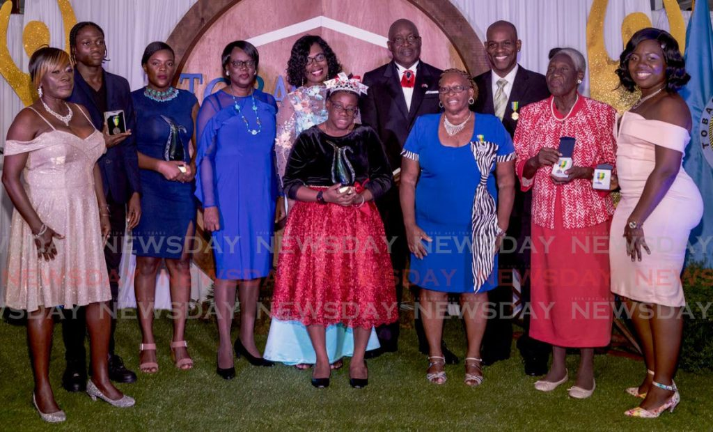 PROUDLY TOBAGONIAN: Tobago Day awardees with Chief Secretary Kelvin Charles, his wife, Catherine, and Chief Administrator Bernadette Solomon-Karoma at the awards ceremony on Wednesday in Scarborough.  - DAVID REID