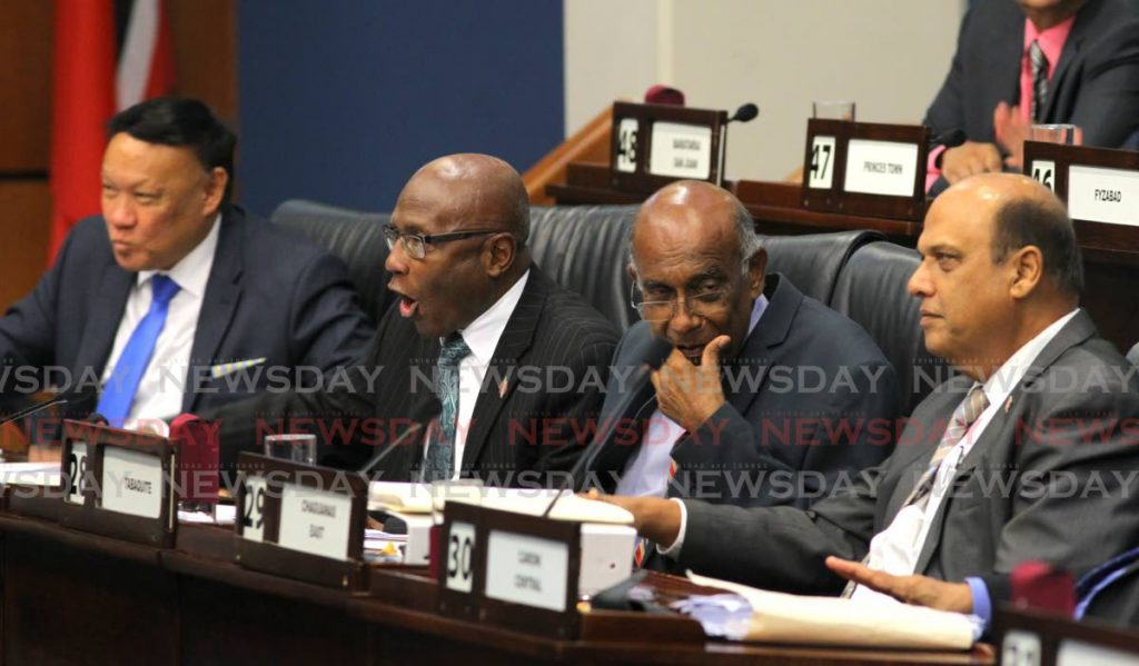 Opposition MPs, from left, David Lee, Rodney Charles, Dr Suruj Rambachan and Fazal Karim during debate in Parliament on Friday. - ROGER JACOB