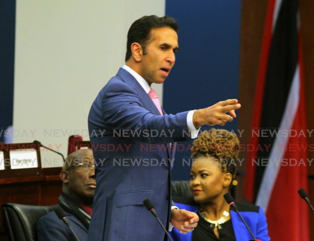 Attorney General Faris Al-Rawi speaks in Parliament on Friday.  - ROGER JACOB