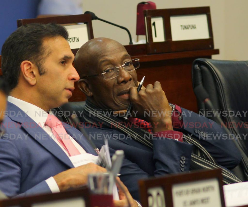 Attorney General Faris Al-Rawi and Prime Minister Dr Keith Rowley during debate on the Finance Bill 2019 in Parliament on Friday. - ROGER JACOB