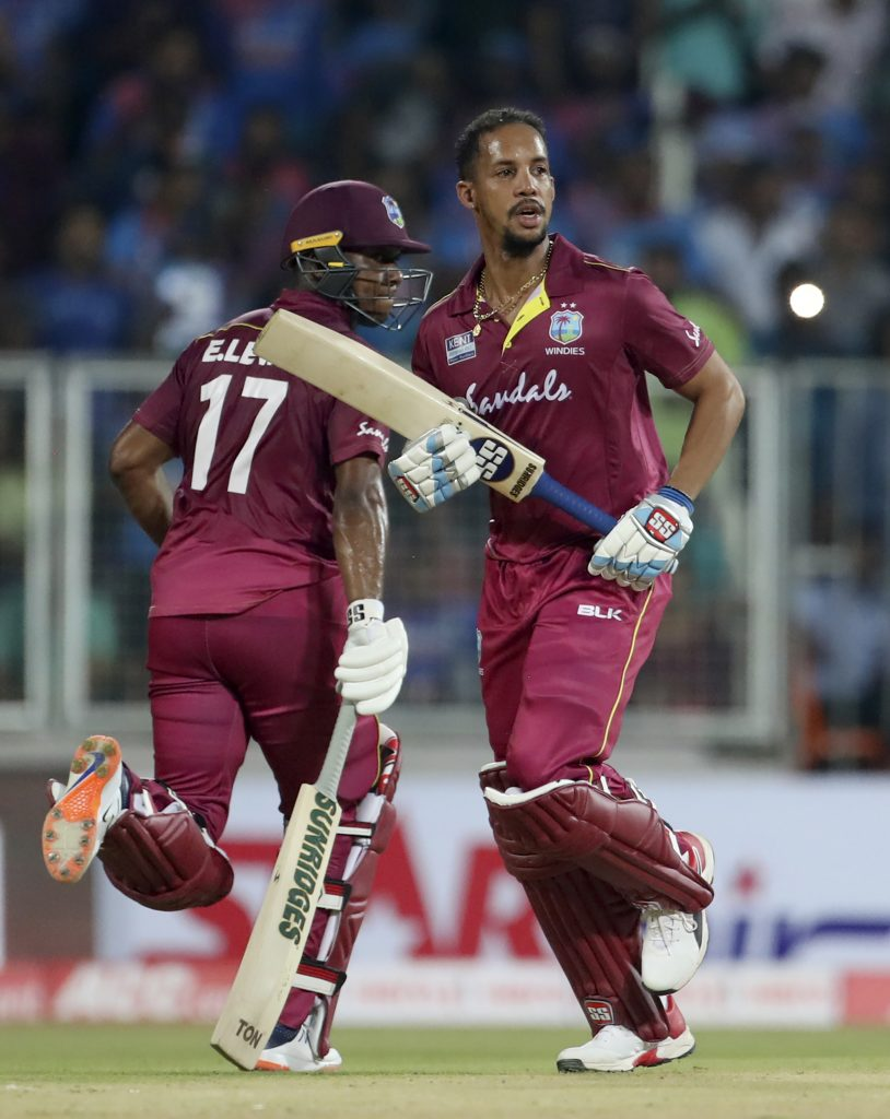 West Indies' Lendl Simmons, right, and Evin Lewis run between the wickets to score during the second Twenty20 international cricket match between India and West Indies on Sunday, Dec. 8, 2019. (AP Photo)