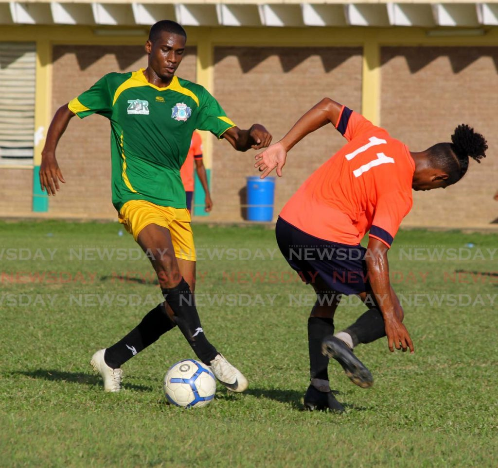 (left) Shandon Joseph, of Guaya United, pulls the ball away from, Moses Jaikaran of QPCC,  at the Terminix Super League - Game Match Queen's Park Cricket Club versus Guaya United FC, St Anthony's College Grounds, West Moorings, Sunday, December 8, 2019. PHOTO BY  - ROGER JACOB