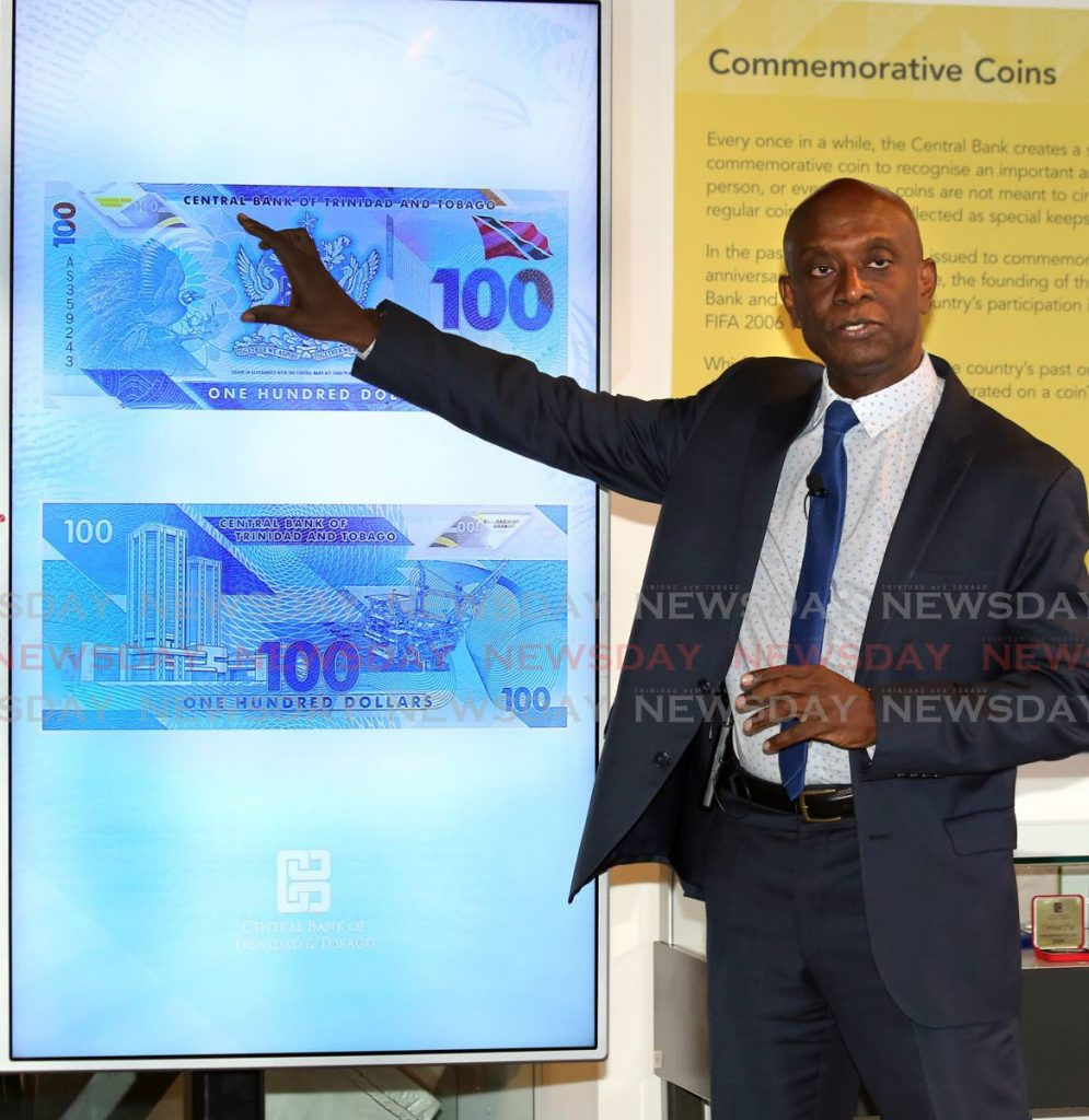 Central Bank governor Alvin Hilaire explains the security features of the $100 polymber bill last Monday. - SUREASH CHOLAI