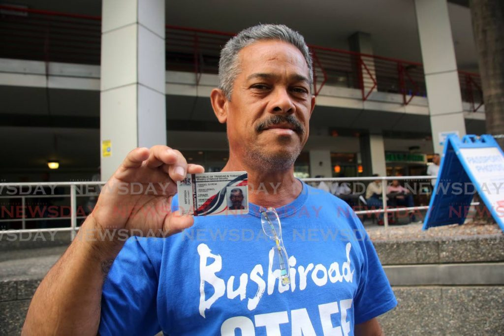 LUCKY JESUS: Venezuelan Rangel Garcia Leonel Jesus displays his government-issued permit which he collected yesterday at the Immigration Department in Port of Spain. PHOTO BY SUREASH CHOLAI - SUREASH CHOLAI