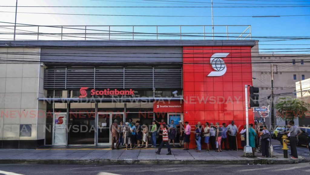 Customers in line  outside Scotia Bank Ltd, Park Street, waiting to exchange their old $100 notes. - JEFF K MAYERS