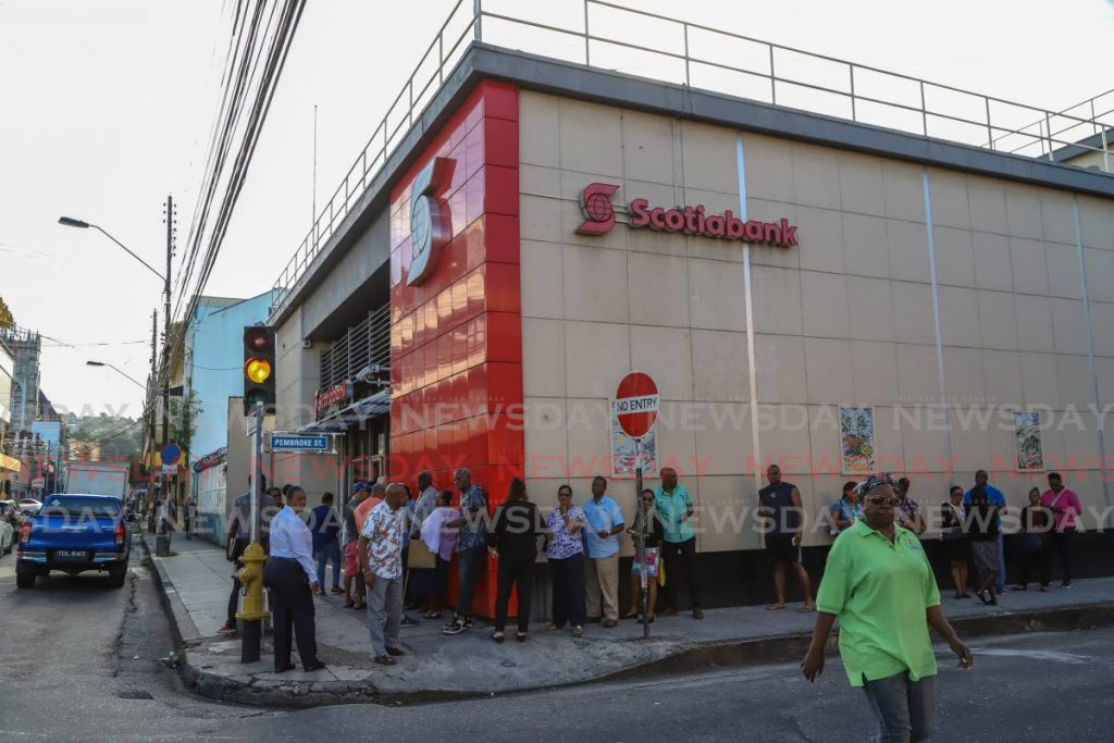 Customers in line  outside Scotia Bank Ltd, Park Street.  - JEFF K MAYERS