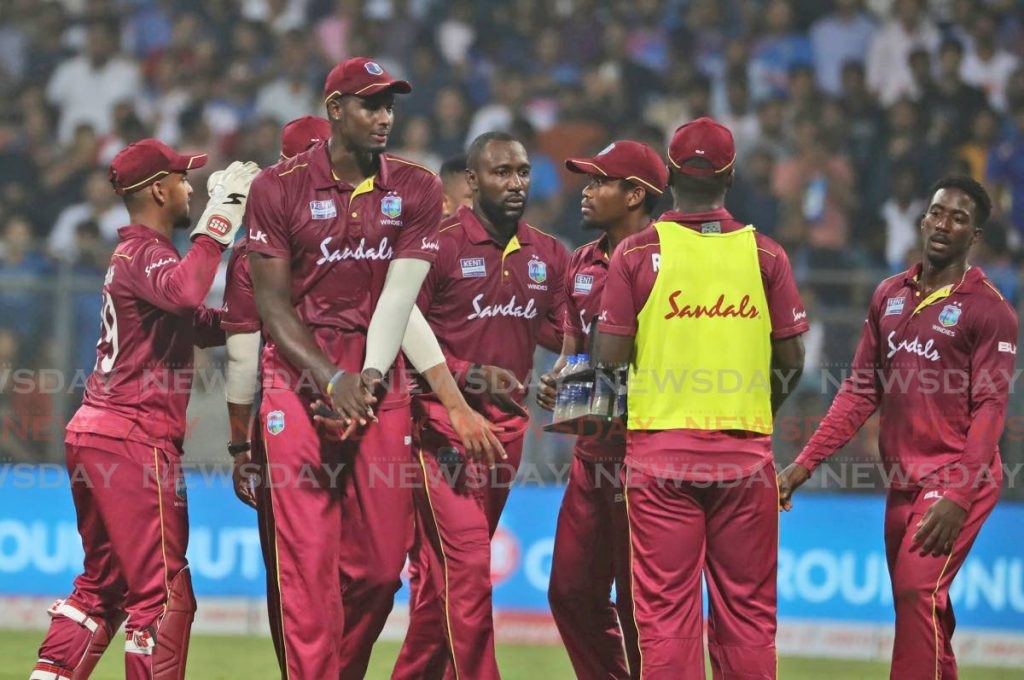 West Indies players celebrate the dismissal of India's Rohit Sharma during the third Twenty20 international between India and West Indies in Mumbai, India, on Dec 11. (AP Photo) -