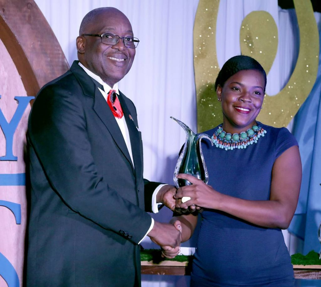 WPC Rheanne Moore of Charlotteville Police Youth Club, right, collects, on behalf of the club, the Chief Secretary award for outstanding contribution and significant achievement in community service from Chief Secretary Kelvin Charles at Tobago Day awards last Thursday.  - THA