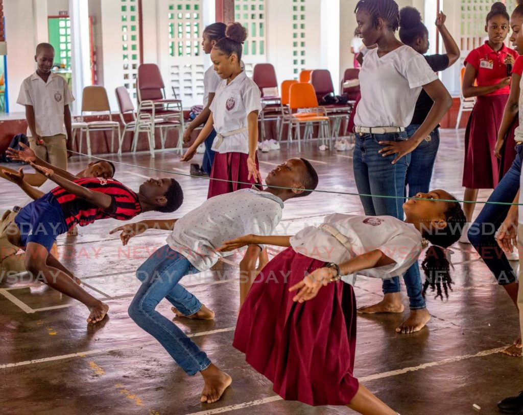 Bishop's High students show their limbo skills on Tobago Day last Thursday.  - THA