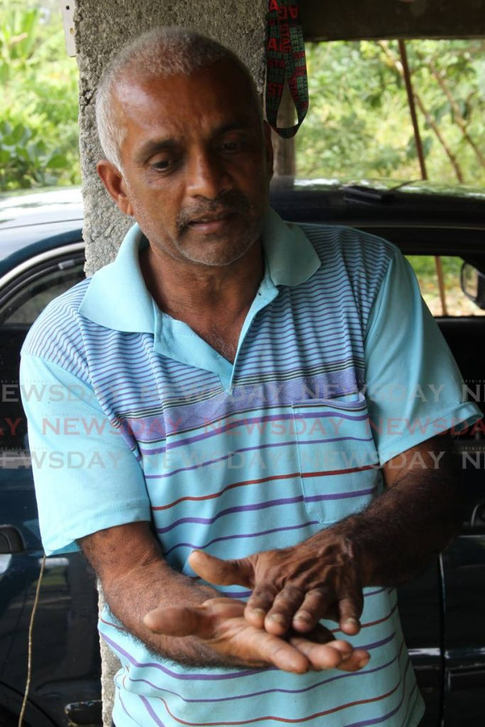 Larry Lakhan, nephew of Ramdeo Lakhan, 67, who was found buried in a shallow grave in Piparo on Wednesday.  PHOTO BY LINCOLN HOLDER - Lincoln Holder
