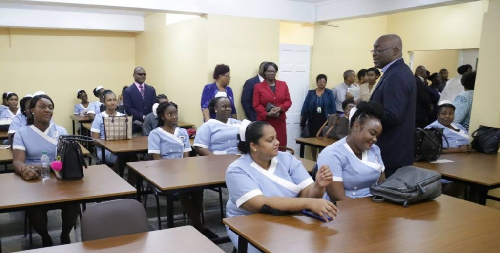 Chief Secretary Kelvin Charles, right, chats with the participants of the enrolled nurses programme at the Tobago Rehabilitation and Empowerment Centre in Scarborough on December 3.  - THA