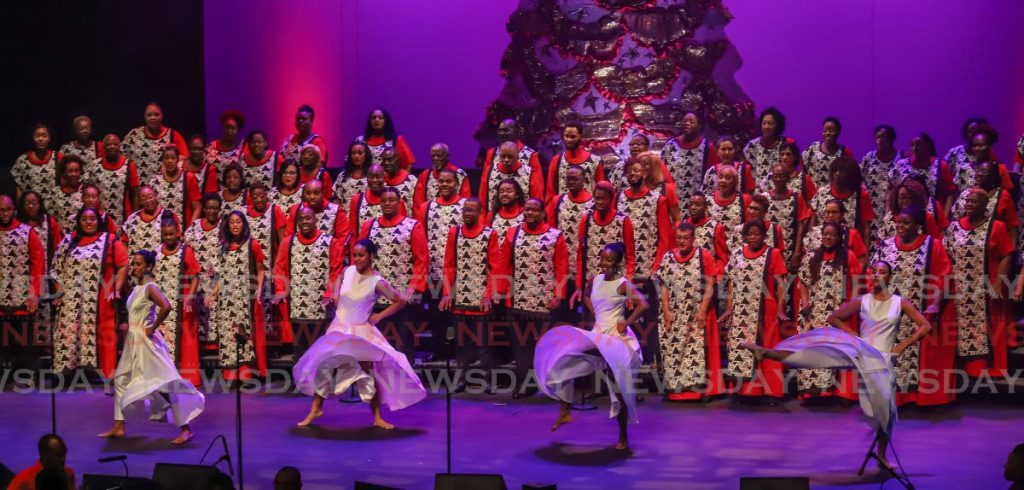 The Lydians performs with dancers at its 40th anniversary Christmas Concert Deo Gratias, last Friday  at Queen's Hall, St Ann's. - JEFF K MAYERS