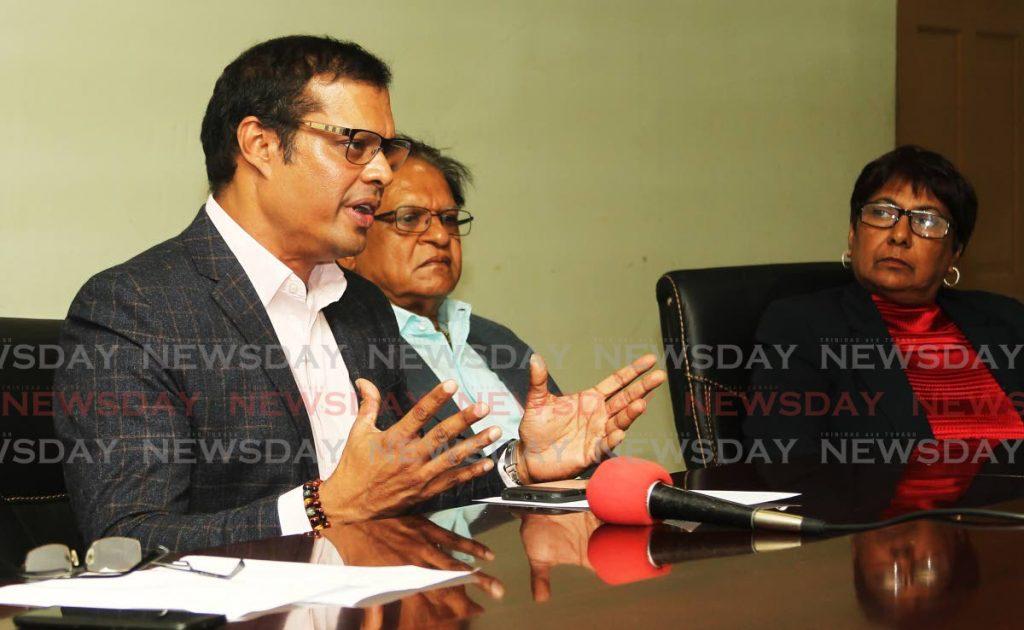 Vivek Charran, president of the San Juan business association (left) - Lincoln Holder