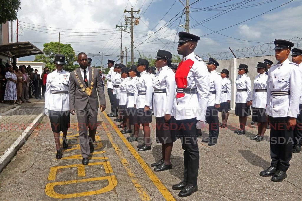 Mayor Kennedy Richards Jr inspects the Point Fortin Municipal Police Unit at the Point Fortin Borough Corporation on Monday. - Marvin Hamilton