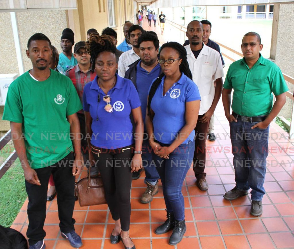 HEALTH WORKERS PROTEST: Members of the Public Services Association, the TT Registered Nurses Association, the National Union of Government and Federated Workers and the National Health Workers Union speak to the media last week after they protested at the Eric Williams Medical Science Complex in Mt Hope. - ANGELO_MARCELLE