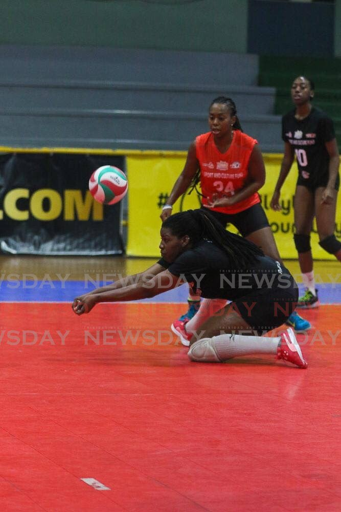 Triple T La Cura Sport's Rheeza Grant makes a pass as teammate Courtnee-Mae Clifford looks on. -