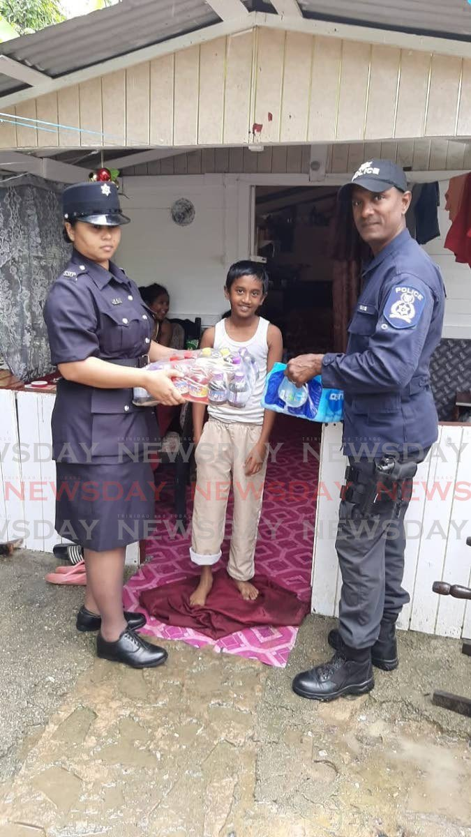 Princes Town Cops Bring Cheers To Needy Families